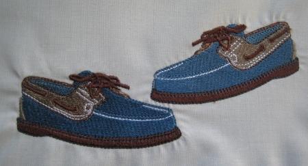 détail broderie pochon chaussures homme