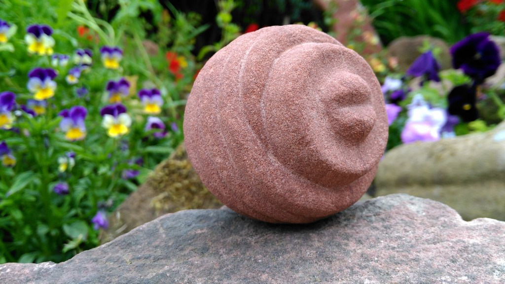 Carved stone ball in Old Red Sandstone