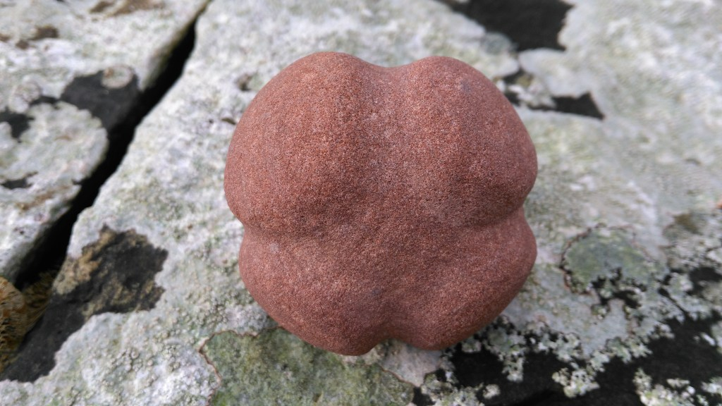 Common Hexamer type carved stone ball, made in Orkney red sandstone.