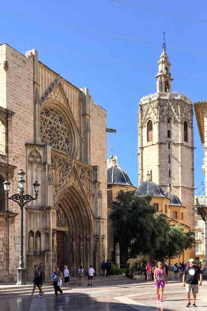 Back entrance to the Valencia Cathedral with the Miguelete Tower - Colourful buildings with balconies in the neighbourhood of Russafa in Valencia - Things to do in Valencia, Spain