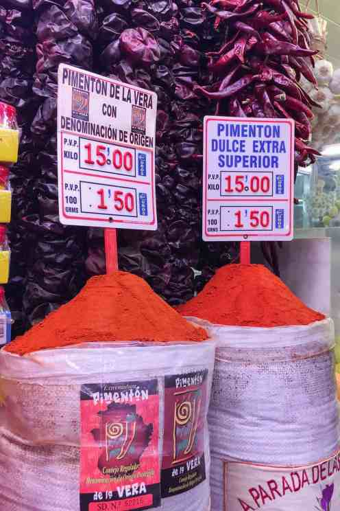 Paprika power in sacks arranged in a mount with price tags in a shop in Valencia