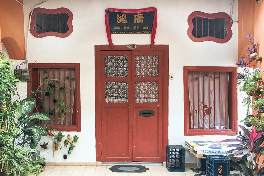 Chinese shophouse with red door and two red windows