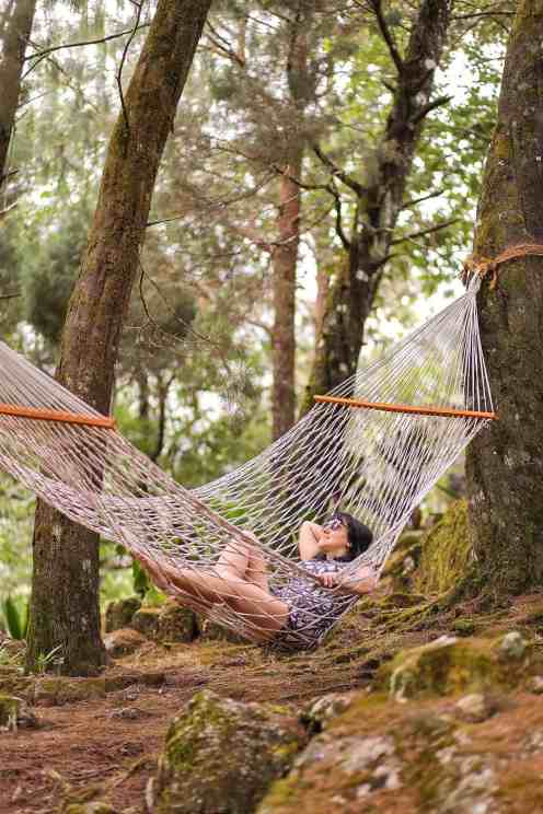 Lying on a hammock in a wooded area in Windermere Estate in Munnar - #munnar #kerala #india