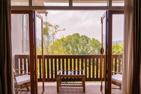 Planter's room balcony with view over Munnar mountains at Windermere Estate - #munnar #kerala #india