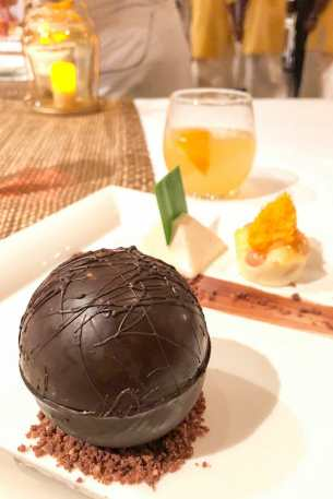 Caramelised banana inside a chocolate sphere at the Cassava Restaurant at the Kochi Marriott Hotel