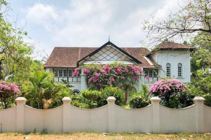 Colonial building in Kochi with a beautiful flower garden