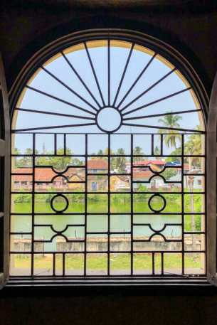 Arched window with decorated grills at Mattancherry Palace