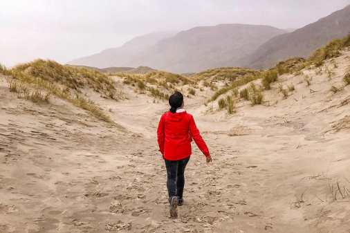 Walking through the sand dunes at Maghera Strand in the rain