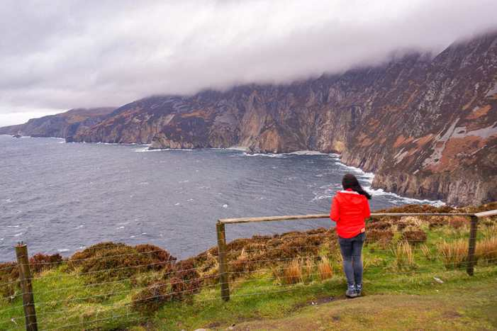 Admiring Slieve League cliffs which have the top covered with clouds