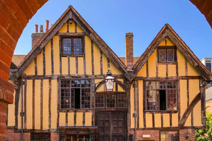 Front facade of yellow timber framed building