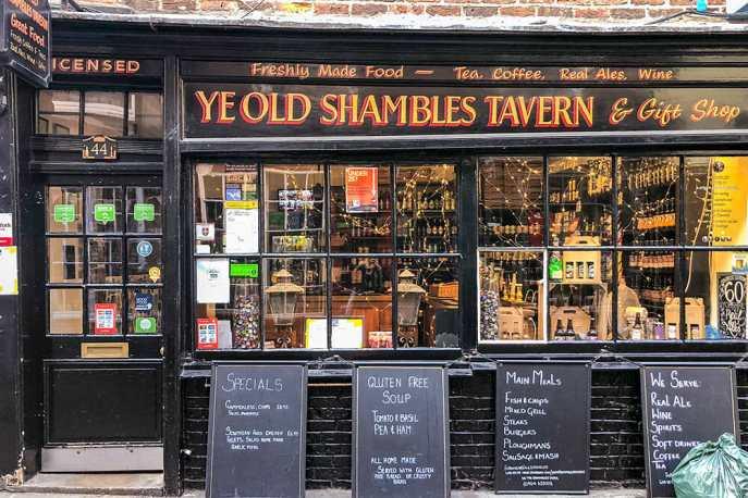 Black Victorian shopfront of Ye Olde Shambles Tavern and Gift Shop