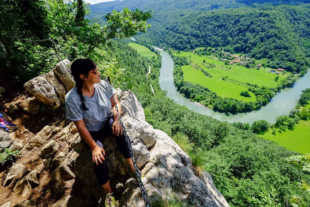 Sitting on a rocky outcrop looking out to the view of the Kolpa Valley