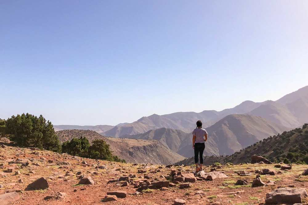 Standing looking over the vastness of the mountains ahead