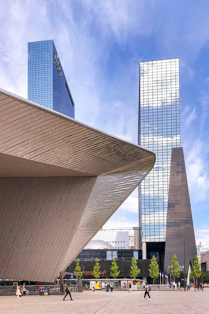 Modern architecture of Centraal Station and glass office buildings
