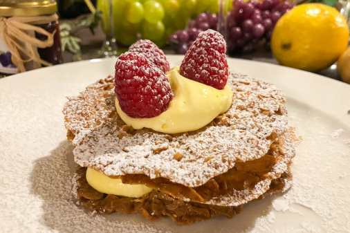 Layered Millefoglie with custard and raspberries on top
