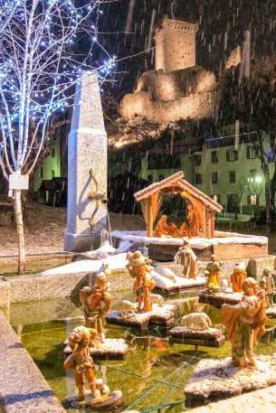 Nativity scene covered in snow with castle in the background