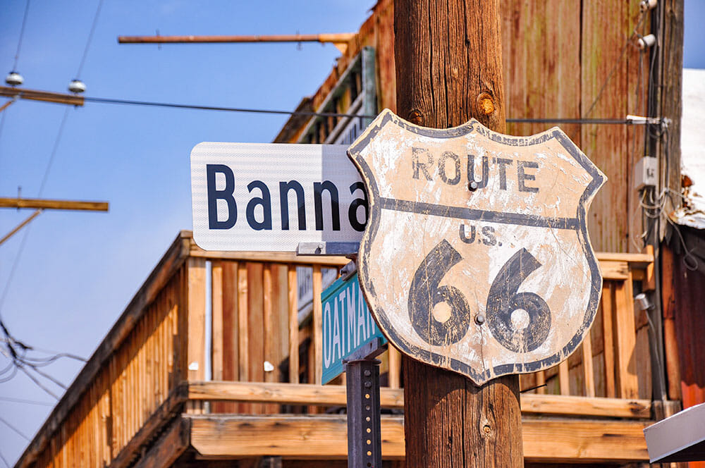 Sign for Route 66 on a wooden post