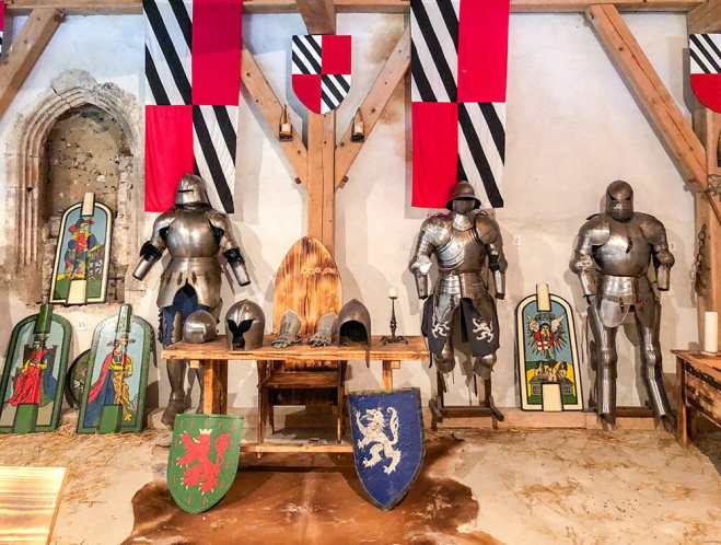Room with shields, medieval armours and flags