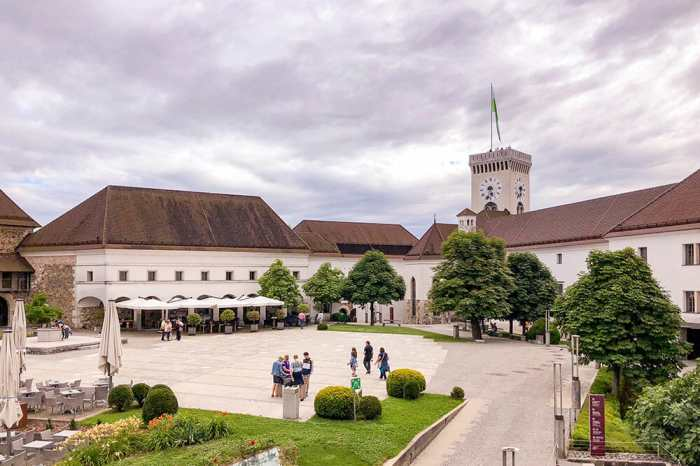 Big square inside Ljubljana Castle with Viewing Tower in the background