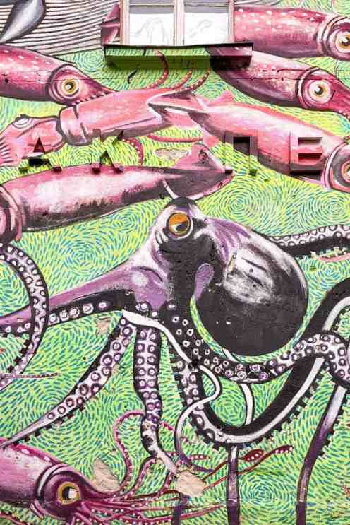 Street art mural with an octopus and lots of squid