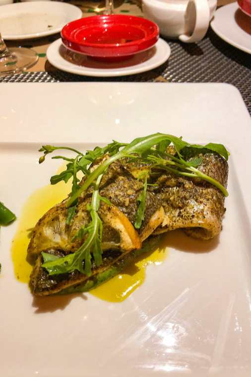 Sea bass cooked with lemons and olives