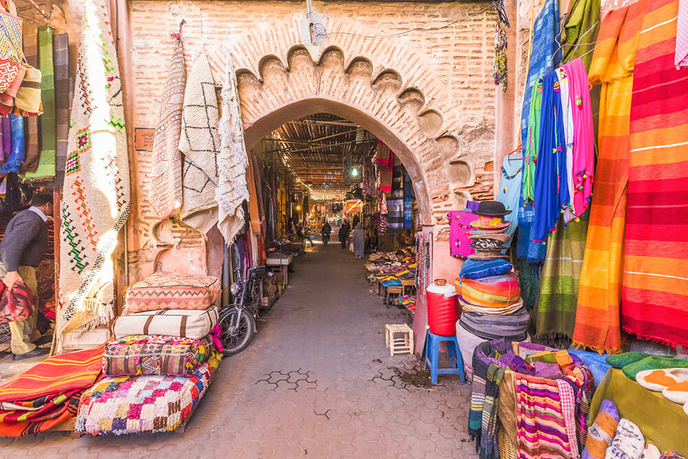 Souk in Marrakech with blankets over an arch
