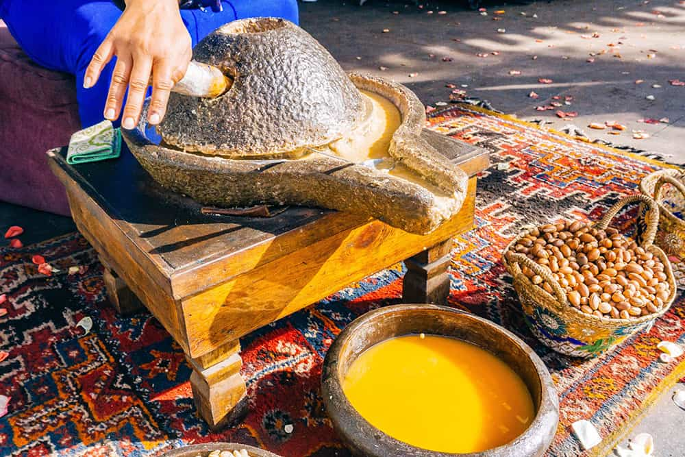 Argan oil being ground in a grinding stone