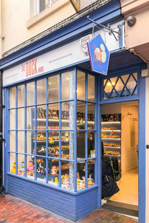 Traditional blue shop front with a sign reading The Duck House