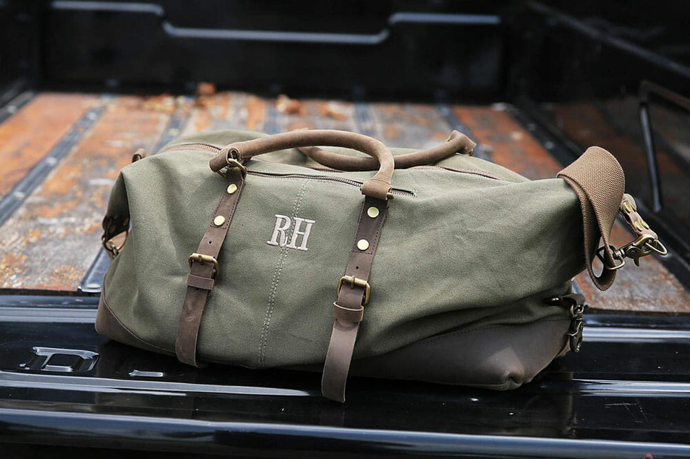 Military green canvas duffel bag with RH embroidered and with leather straps