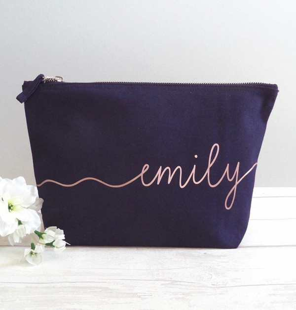 Navy blue canvas make up bag with the name Emily painted on it