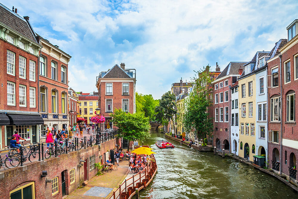 Dutch canal lined up with traditional Dutch houses - Utrecht is a great spring destination in Europe