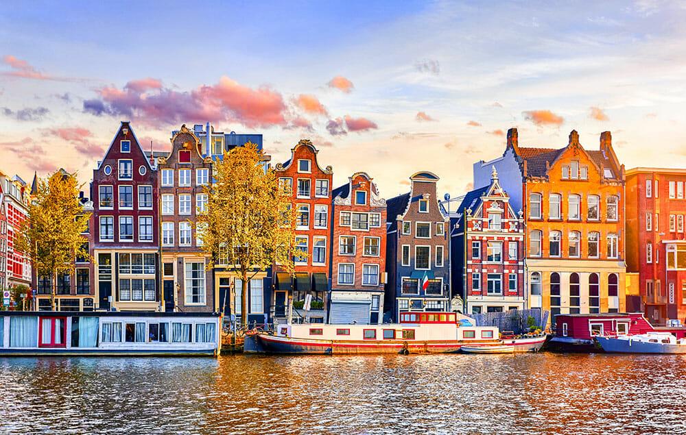 Tall narrow Dutch houses on the edge of a canal