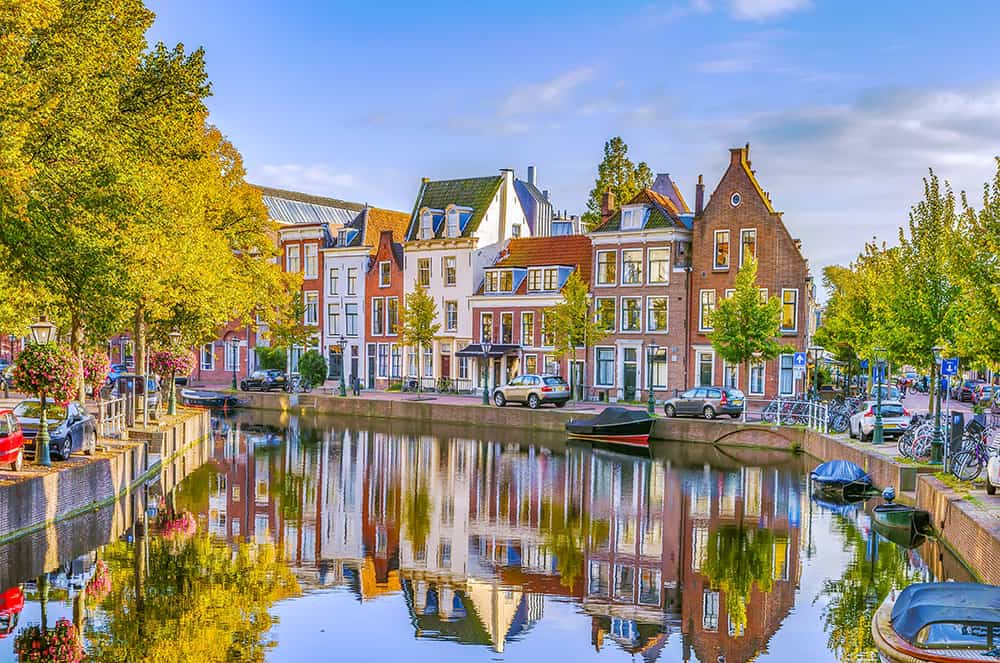 Small Dutch houses along a curving canal