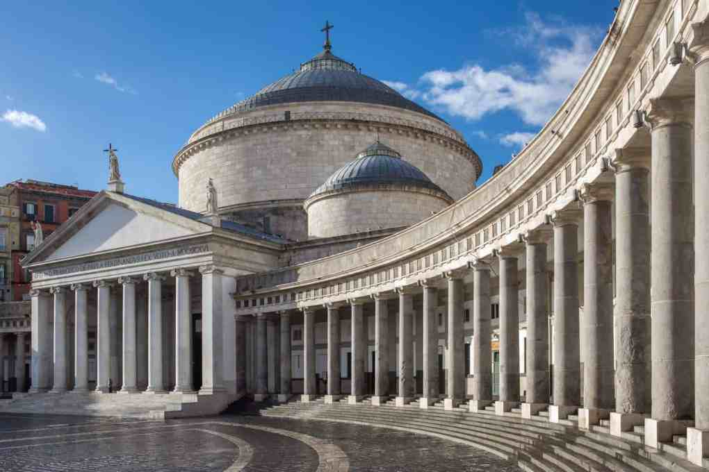Colonnade and domed building in a city square