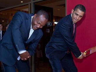 Photo of Brian Lara teaching Barack Obama cricket