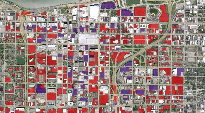 Parking in Downtown Louisville. Red is surface parking, purple is single-use garages. (Erik Weber)