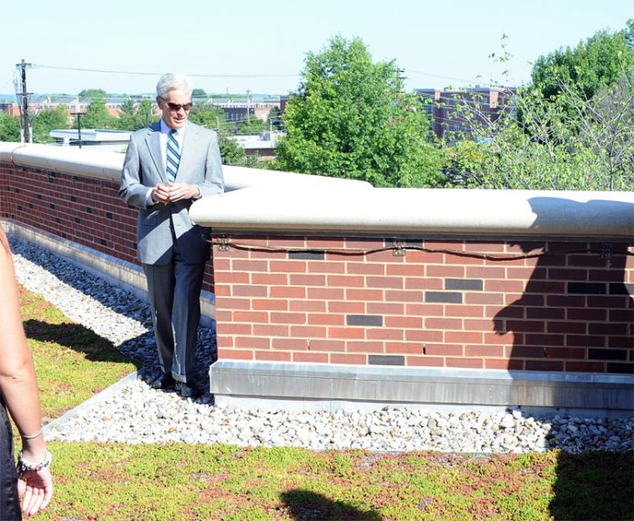 Henry Heuser inspects the new green roof at the dedication. (Courtesy UL)