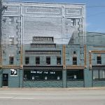 The Grocer's Ice & Storage Building lost its top two floors & its future is uncertain.