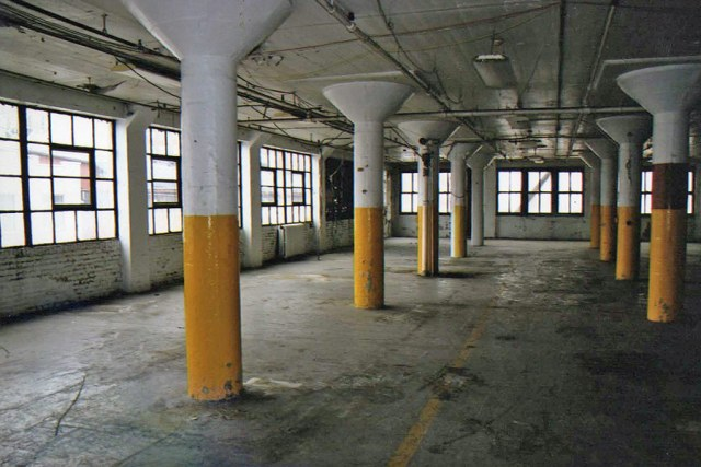 The building's interior retains its industrial aesthetic. (Courtesy NRHP)