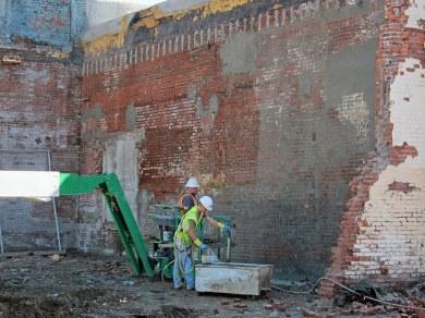 Patching the brick walls. (Branden Klayko / Broken Sidewalk)