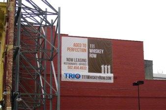 A sign for 111 Whiskey Row. (Porter Stevens)