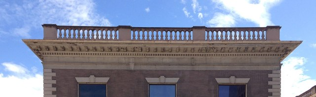 A portion of the Water Company Building balustrade. (Branden Klayko / Broken Sidewalk)