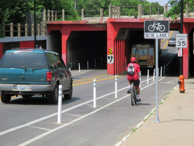 A buffered bike lane with bollards on Fourth Street near the University of Louisville. (Courtesy Bike Louisville)