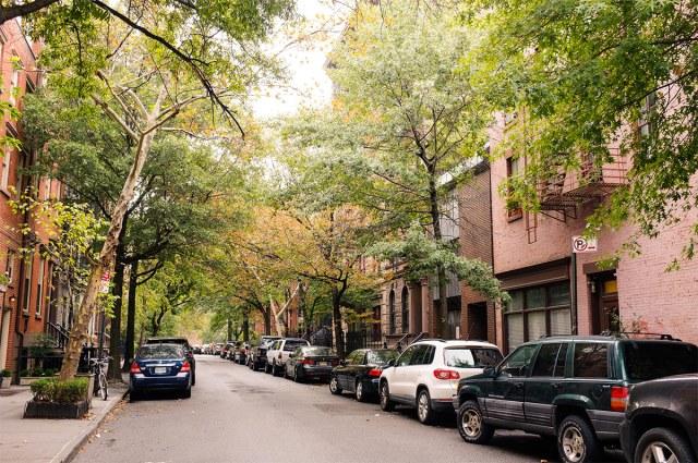A tree-lined street in an affluent Manhattan neighborhood. (heipei / Flickr)