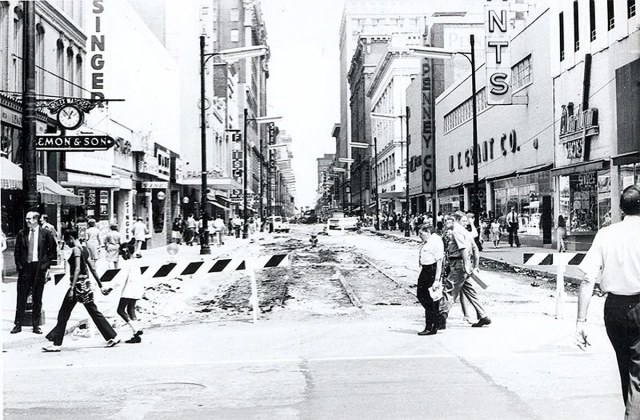 After Fourth Street's road bed was peeled away in preparation for mall work, the old streetcar lines can still be seen running down the center of the street. (Brokn Archives)