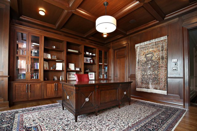 The wood-paneled office at the Hacet Residence. (Courtesy Burrus Architecture & Construction)