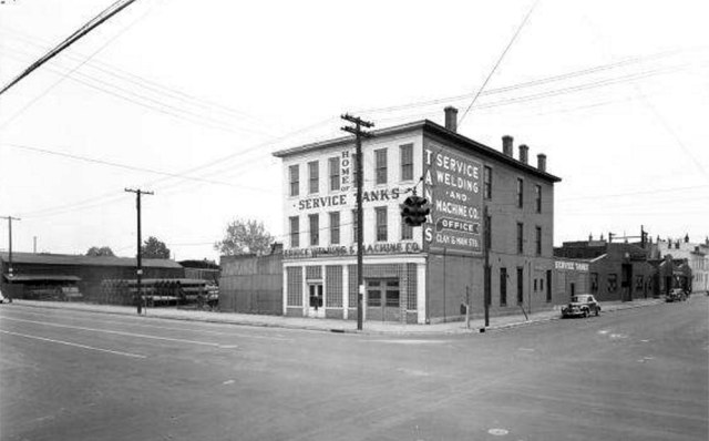 A 120-plus-year-old, three-story corner commercial building is slated for demolition under the current plant plan. Seen here circa 1948 before construction of the large blue warehouse. (Courtesy UL Photo Archives - Reference)