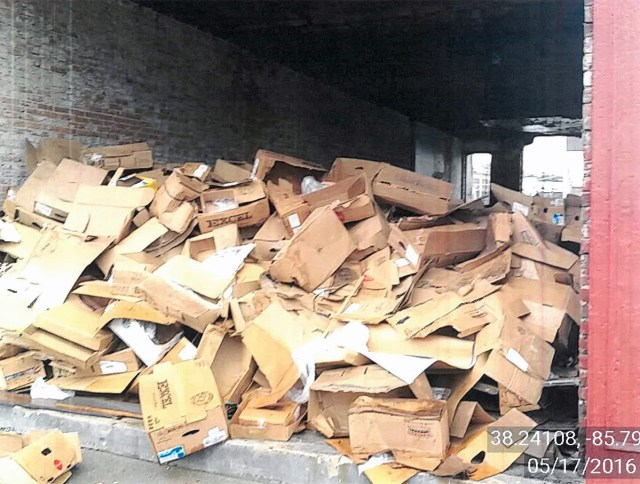 Several violations were issued for leaving large amounts of debris, like these cardboard boxes, around the property. (Courtesy Metro Louisville)