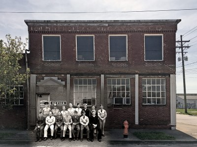 A group of veterans pose in front of the John H. Isert Co., now Interapt's headquarters, in 1944. Underlaid with a modern view of the building. (Historic image courtesy UL Photo Archives - Reference; Building photo and montage by Broken Sidewalk)