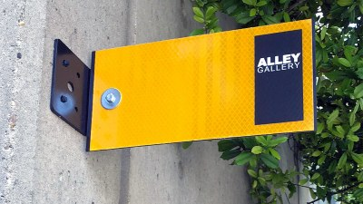 Alley Gallery turns dingy metal doors into works of art in Downtown, Nulu